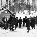 WP00277: Fred Wells leaving the Cariboo Gold Quartz with the first gold brick on his back, ca. 1933.